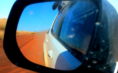 Objects in the rear-view mirror may appear closer than they are